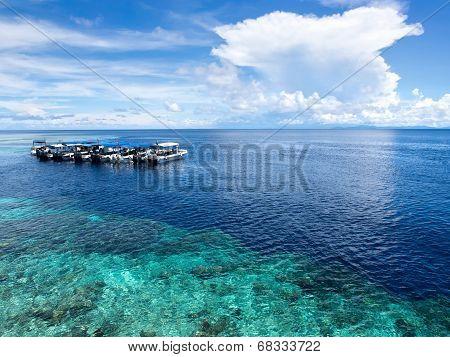 Boats At Dive Site In Sipadan Island, Sabah, Malaysia