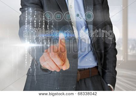 Businessman touching the words affliate marketing on interface against abstract white line design in room