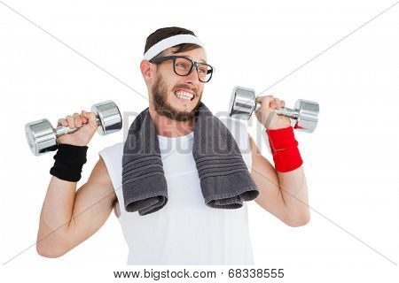 Geeky hipster lifting dumbbells in sportswear on white background