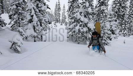 Snowboarder Stepping Snow
