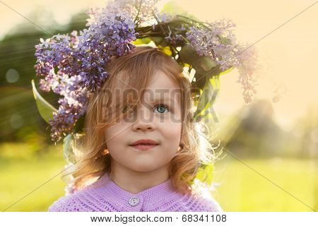 Little girl in lilac garland