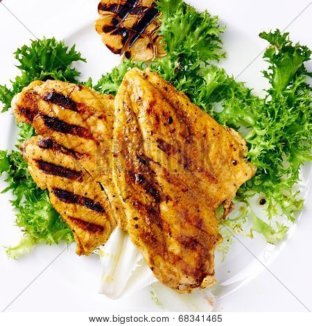 Grilled chicken breast with grilled garlic