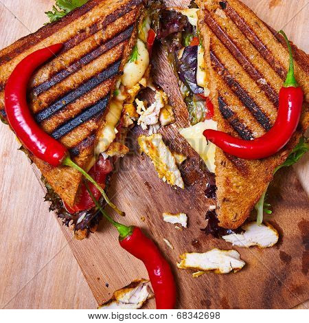 Hot and spicy club sandwich with chicken