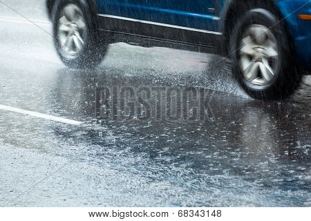 Blue Car On Wet Road