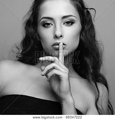 Sexy Expression Female Model With Silent Sign. Black And White Portrait