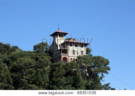 PORTOFINO, ITALY - MAY 04, 2014: Beautiful old villa on the cliff in Portofino, Italian fishing village famous for its picturesque harbor, Portofino. Italy, on May 04, 2014