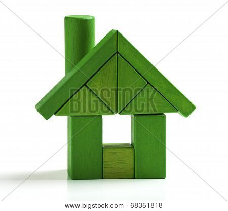 Green House, Energy Efficiency Home Save Heat And Ecology. Toy Blocks Isolated White Background