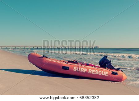 Surf Rescue Rubber Boat on Beach with Retro Effect