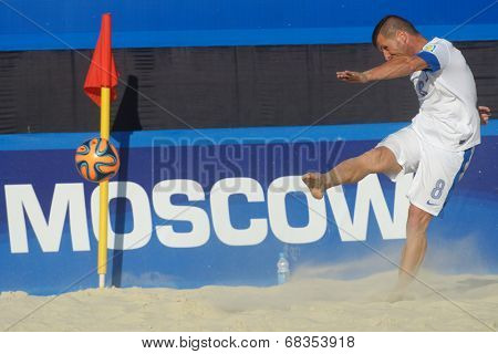 MOSCOW, RUSSIA - JULY 13, 2014: Theofilos Triantafyllidis of Greece performs the corner kick in the match with Belarus during Moscow stage of Euro Beach Soccer League. Belarus won 6-5