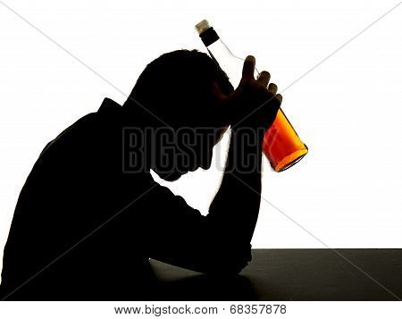 Silhouette Of Alcoholic Drunk Man Drinking Whiskey Bottle Feeling Depressed Falling Into Addiction P