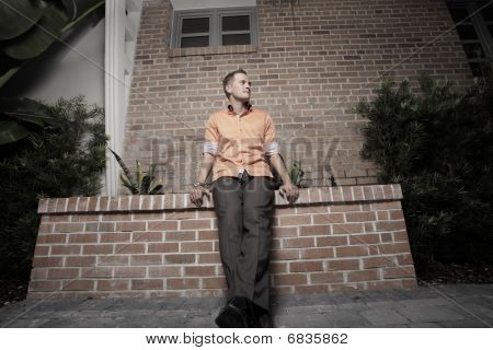 Man posing by a building