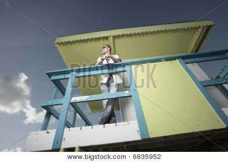 Man on a lifeguard stand