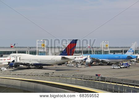 Delta Airline Boeing 747 and KLM Boeing 777 at the gates at the Terminal 4 at JFK Airport