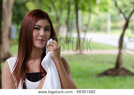 Pretty Young Woman Wiping The Sweat