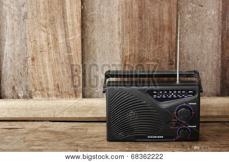 Old Transistor Radio On Wooden Background