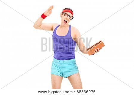 Nerdy guy trying to break a brick isolated on white background