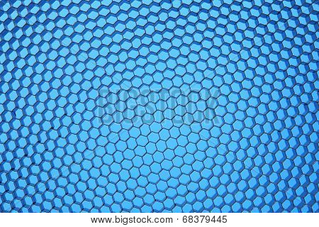 Hexagonal mesh on a blue background.