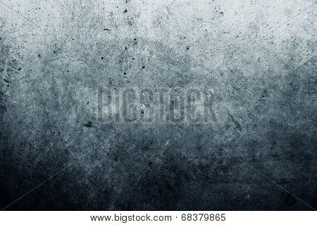 Grunge blue textured wall closeup