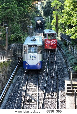 LUGANO, SWITZERLAND - JULY 5, 2014: Two funicular cars passing each other in Lugano. The Funicolare Lugano Citta� ??Stazione is a short line connecting the Lugano railway station to the city center.