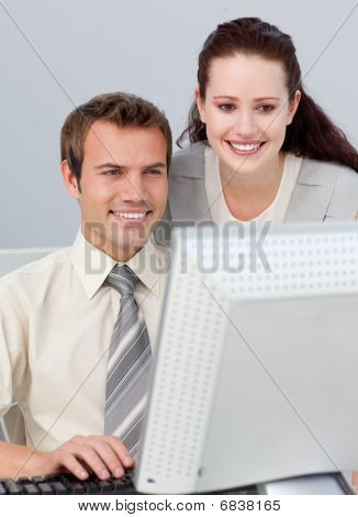 Young Manager Checking Her Employee's Work In The Office