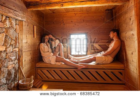 Young couple relaxing in a hot sauna