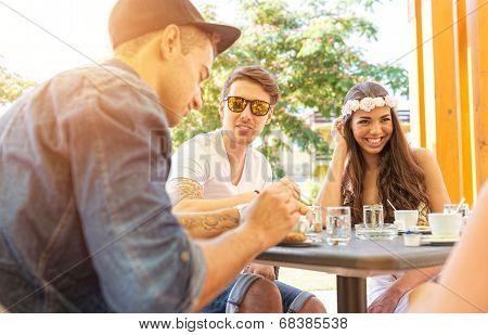 Good friends talk on the terrace