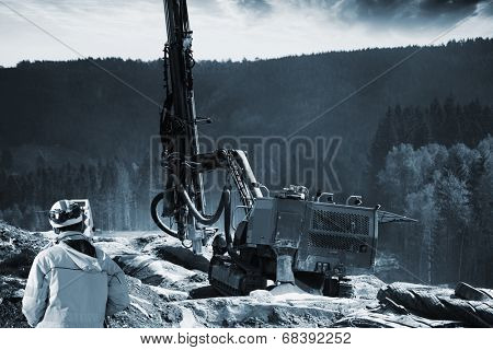 surveyor with drilling machine for dynamiting in rocks and mountains
