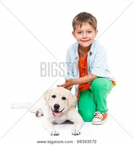 Cute little boy with his labrador