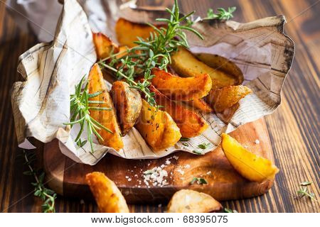 Roasted potato wedges with herbs and salt