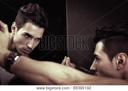 Narcissistic Young Man Admiring His Reflection