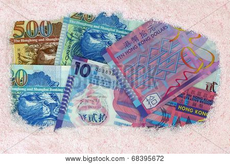 Money laundry : Hong kong dollar banknotes under pink Laundry washing powder