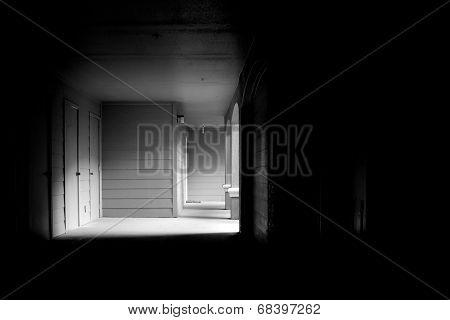 Dark Corridor Leading To Outside Light