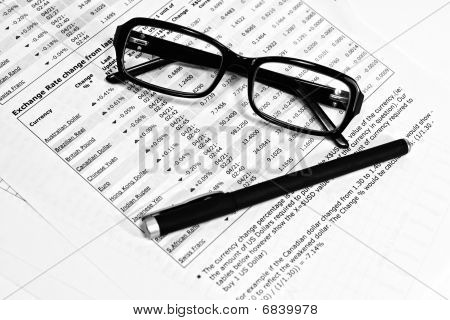Glasses, Financial Documents And Pencil