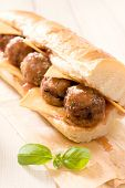stock photo of meatball  - Submarine sandwich stuffed with meatballs and tomato sauce - JPG