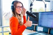 pic of presenter  - female Presenter in radio station hosting show for radio live in Studio - JPG