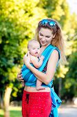 foto of sling bag  - Young mother and baby in a sling - JPG