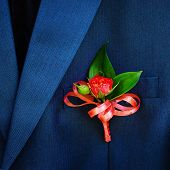 stock photo of boutonniere  - Wedding boutonniere on suit jacket of groom - JPG