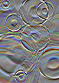 picture of divergent  - Divergent iridescent circles on a gray glowing background - JPG