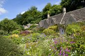 image of english cottage garden  - Cotswold cottage in the popular tourist destination of Bibury, Gloucestershire, England.