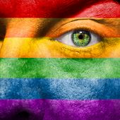 pic of gay flag  - Rainbow Flag painted on face to show gay pride support - JPG