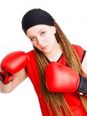 Young Woman Fighter With Boxing Gloves Over White