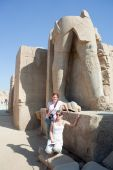 Tourists Against Statues In Karnak Temple poster