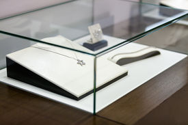 picture of jewel-case  - Jewelry in the window case at jeweler - JPG