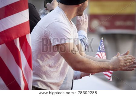 NEW YORK - NOV 11, 2014: A U.S. vet with a USMC tattoo during the 2014 America's Parade held on Veterans Day in New York City on November 11, 2014.