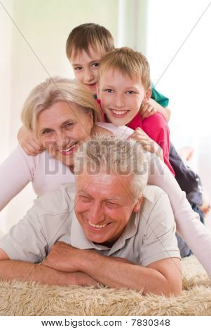 Family Playing On A White