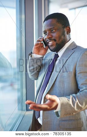 Confident young businessman talking on the phone