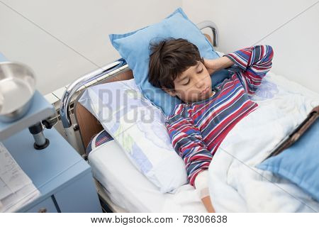 Child patient in hospital bed