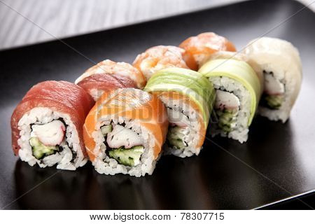 Sushi Maki roll assortment on black dish