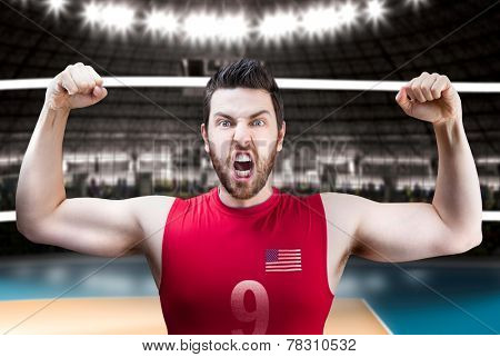American volleyball player celebrates on volleyball court.