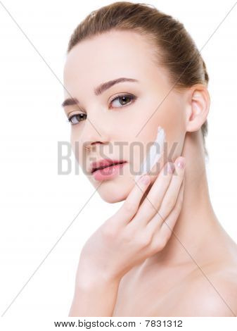 Face With Moisturizer Cosmetic Cream On Cheek